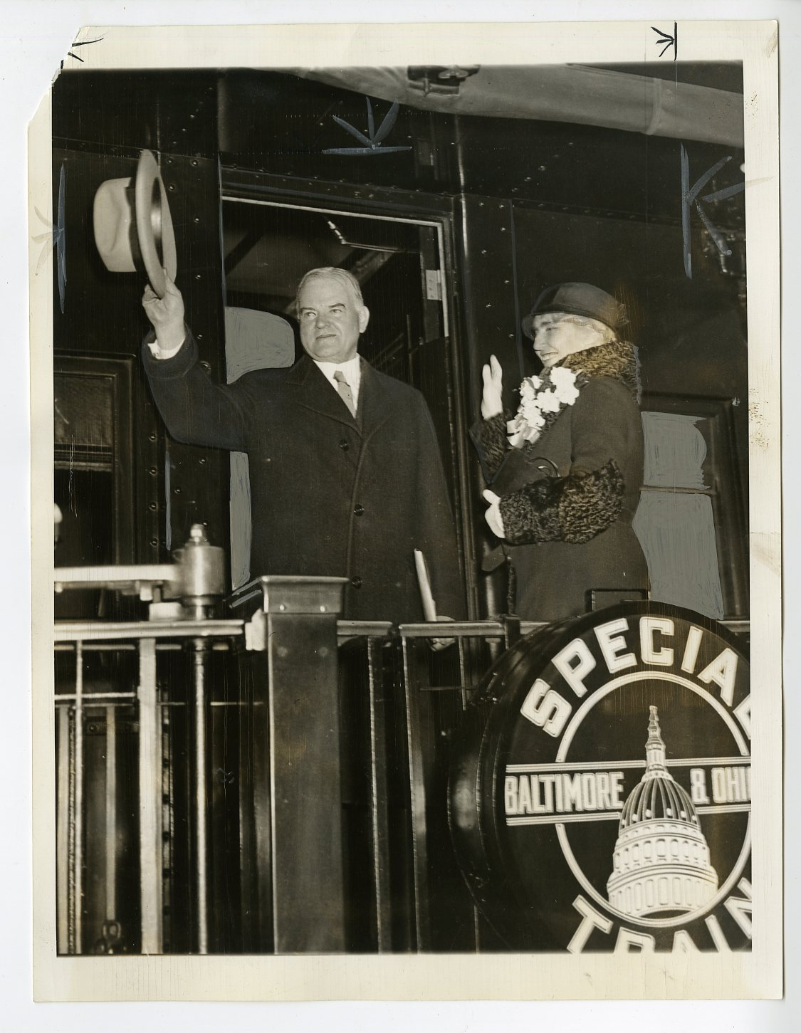President and Mrs. Hoover photographed in the rear of a train that they traveled in. November 3, 1932