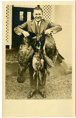 31-AL-56 Lawrence Richey with the turkeys he shot for the Hoover Thanksgiving dinner. 1930