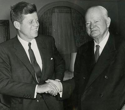 President John F. Kennedy calls on former President Hoover at Hoover's Waldorf Astoria apartment.