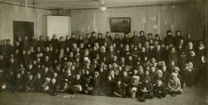 Children waiting for their Christmas dinner in one of the ARA kitchens. Reveal ca. 1920