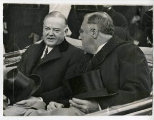 Herbert Hoover with president elect Franklin D. Roosevelt  as they leave the White House on the way to the inauguration ceremonies.