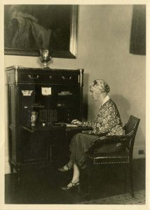 "Lou Henry Hoover sitting at the ""Monroe Desk"" ithat was reproduced for the White House collection. ca 1931"