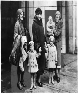 Margaret Hoover, First Lady Lou Hoover,  and nurse (holding Joan) arrive at Union Station in Washington, 12/8/1930. The nurse is unidentified.